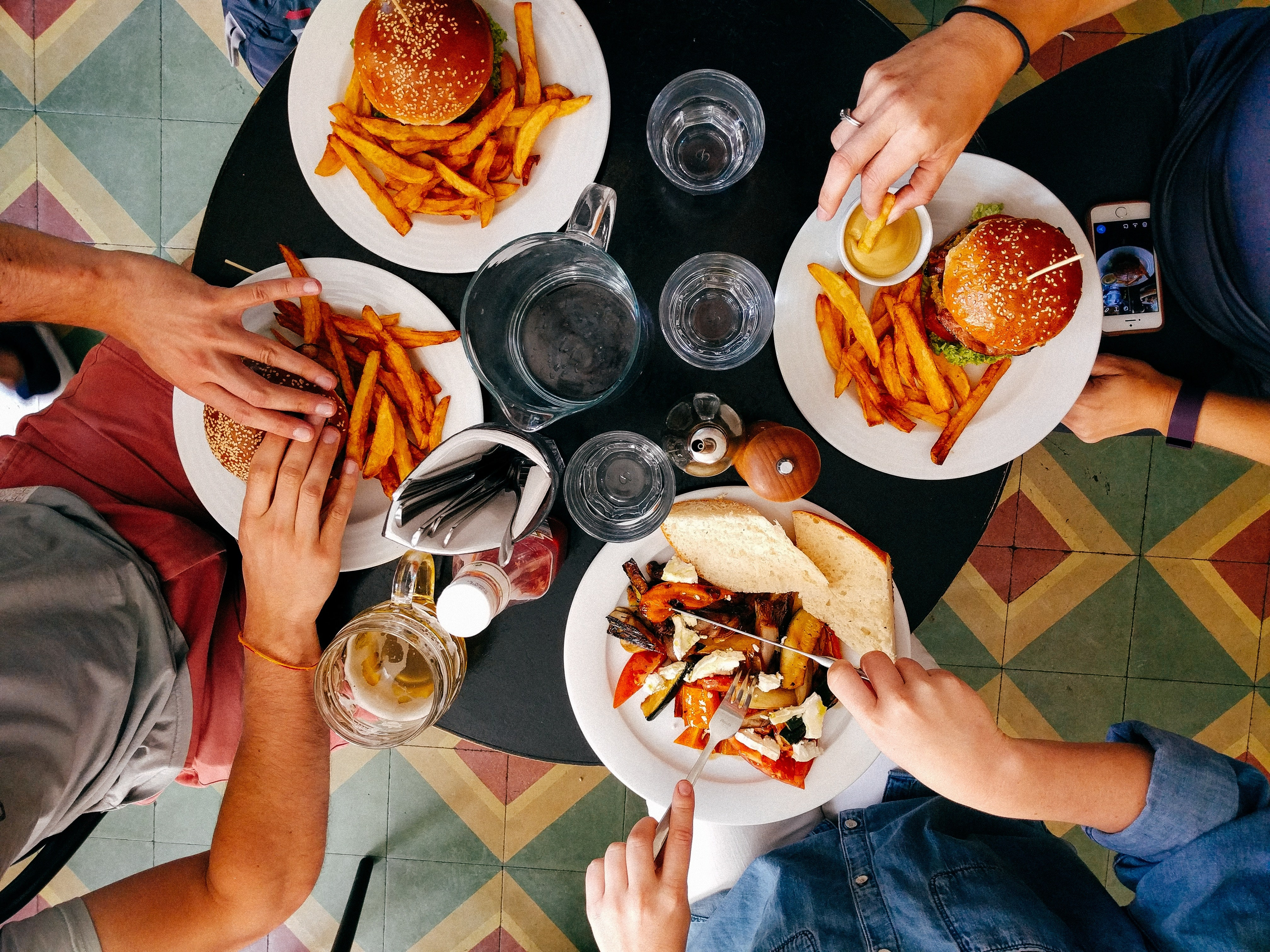 Group Travel, family dinners, Photo by Dan Gold on Unsplash