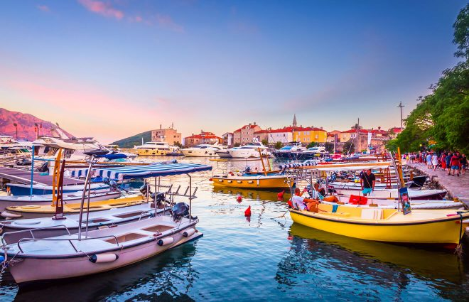 Budva coast with boats and old town